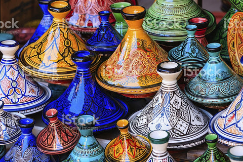 Colorful Maroccan tajine pots at a souk in Marrakech - Stock image
