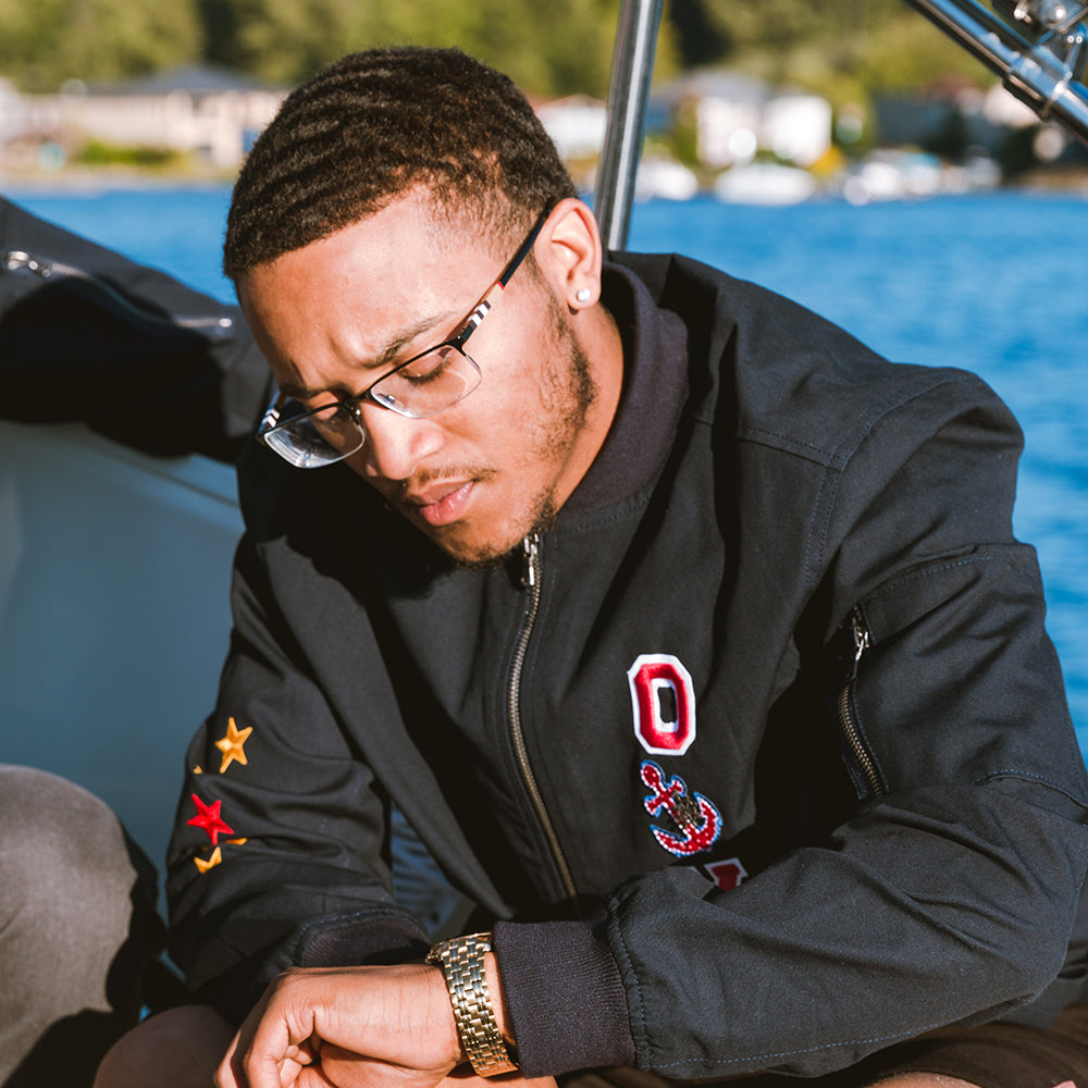 Oy Brand male model on yacht with  jacket