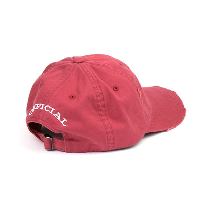 side view of distressed red hat