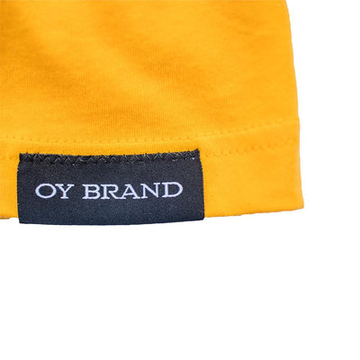 gold oy brand t-shirt with black hem label.
