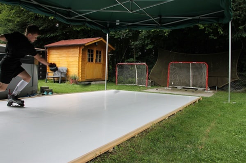 Young Boy Training on Glice Synthetic Ice Pad in Their Garden