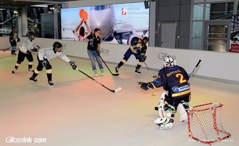 People playing hockey on Glice Synthetic Ice Rink