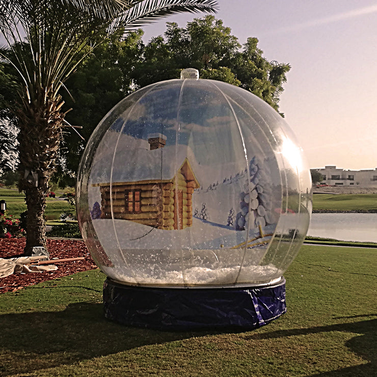 Desert Snow's Giant Inflatable Snow Globe installed for a private party at the Montgomerie Golf Club Dubai
