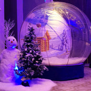 Desert Snow's Giant Inflatable Snow Globe added with a winter scene for a private party at Taj Dubai