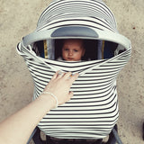 baby inside baby carseat that has been covered with a thin black stripes and thick white stripes cotton capsule cover