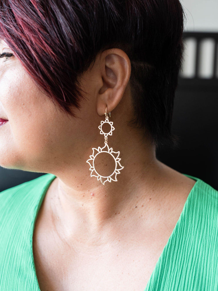 gold finish lightweight metal sun dangle earrings available online at vetue boutique
