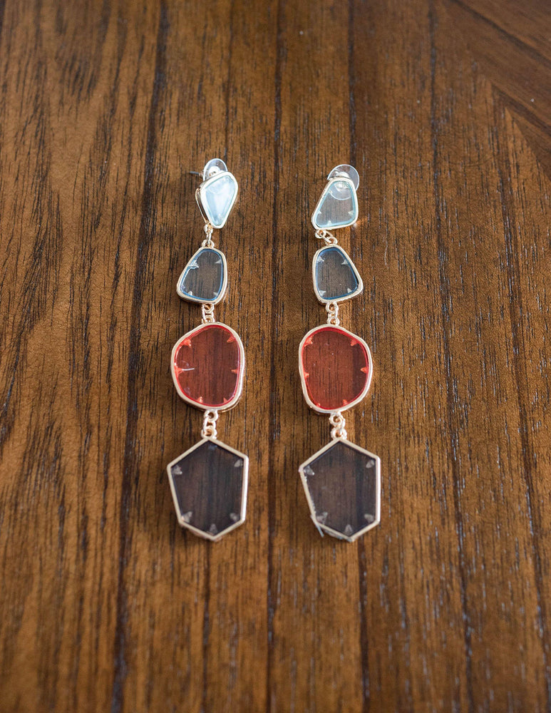 multi color clear acrylic dangle earrings available online at vetue boutique