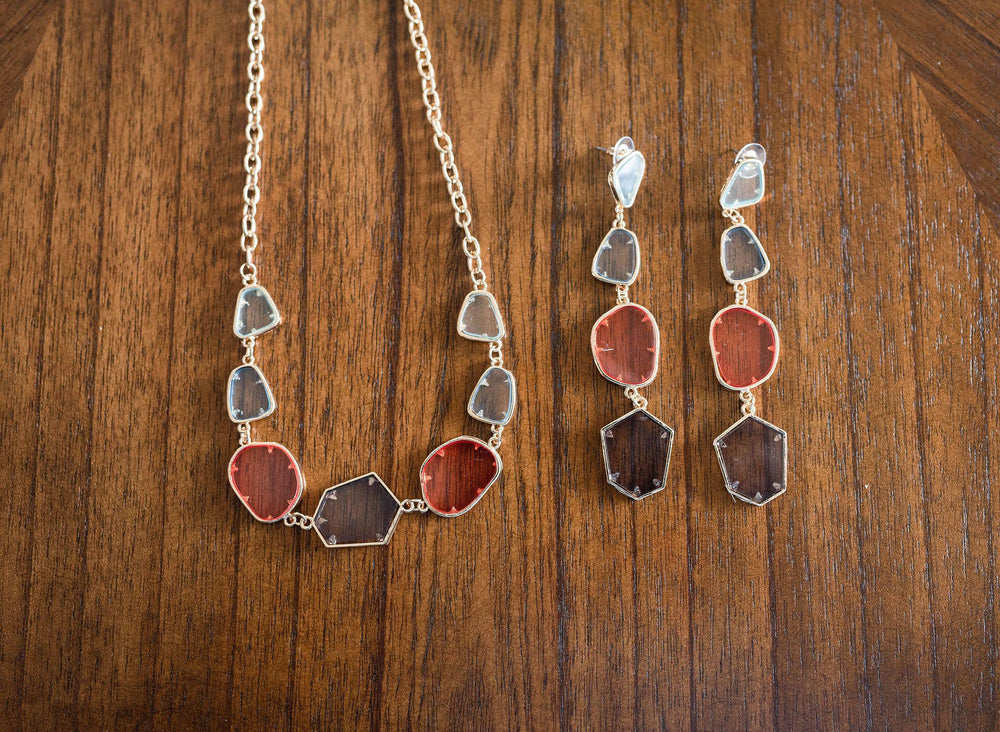 seen with matching earrings multi color clear acrylic necklace available online at vetue boutique