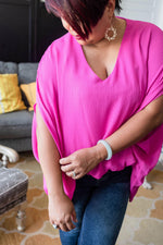 sleeve detail fuchsia drape v-neck blouse available online at vetue boutique