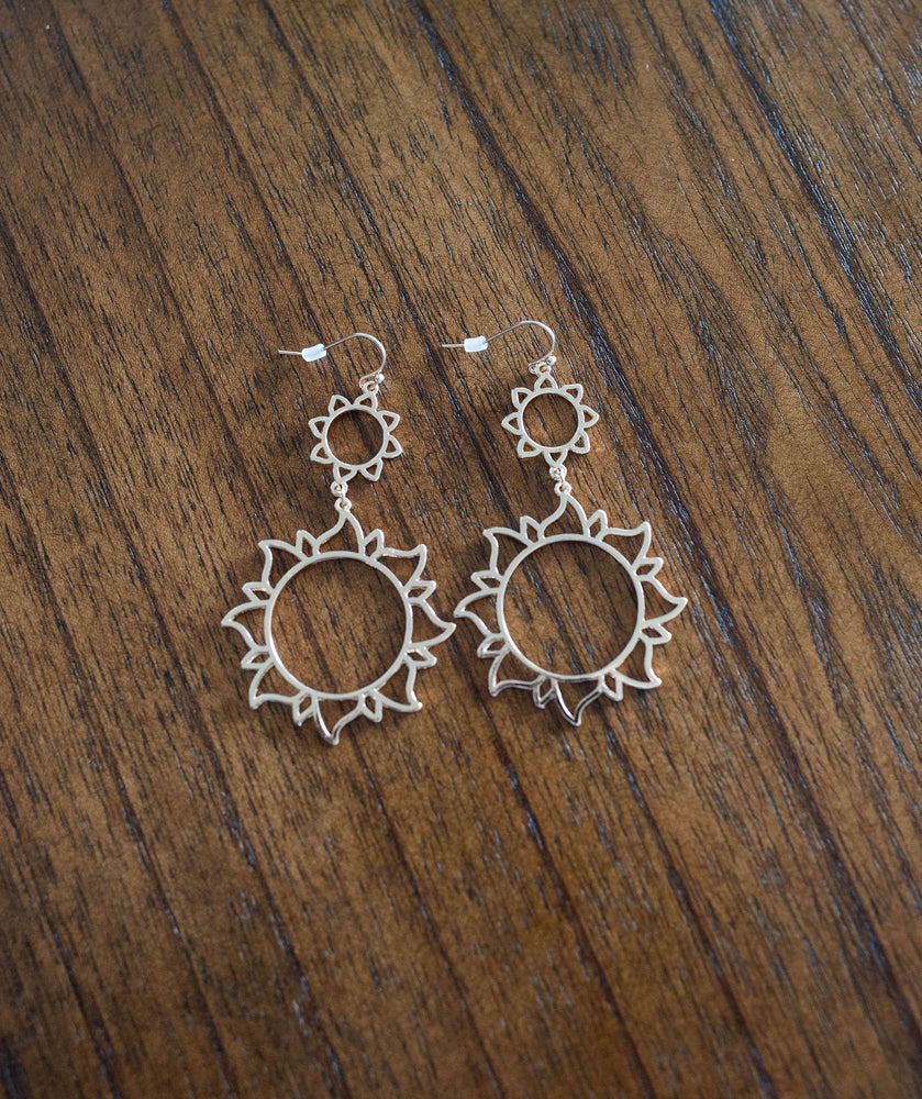 silver finish lightweight metal sun dangle earrings available online at vetue boutique