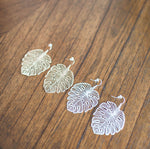 monstera leaf statement earrings in gold or silver available online at vetue boutique