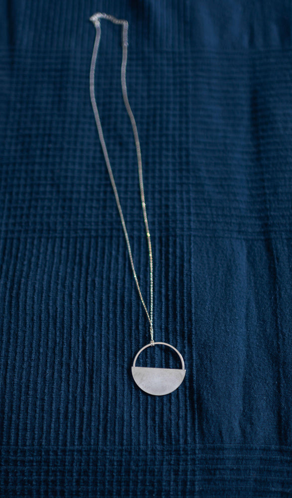 flat round silver finish necklace available online at vetue boutique