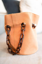 Camel faux suede bucket bag with acrylic chain handles
