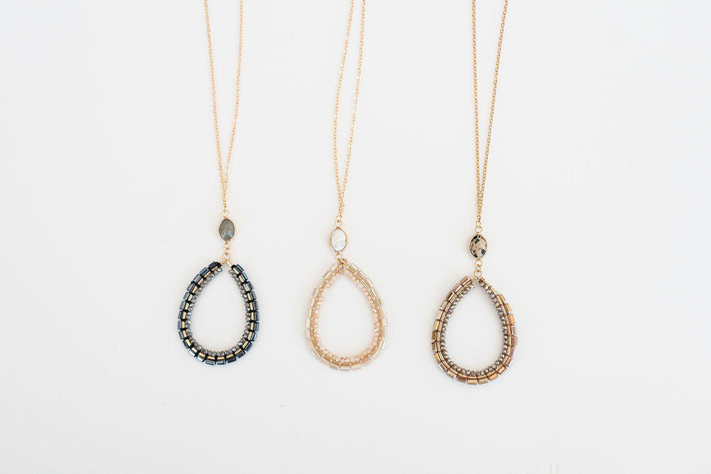 gold finish necklace with bead teardrop detail and drop earrings