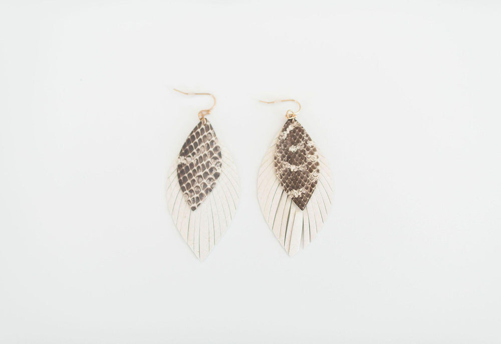 white fringe edges leather earring snake detail available online at vetue boutique
