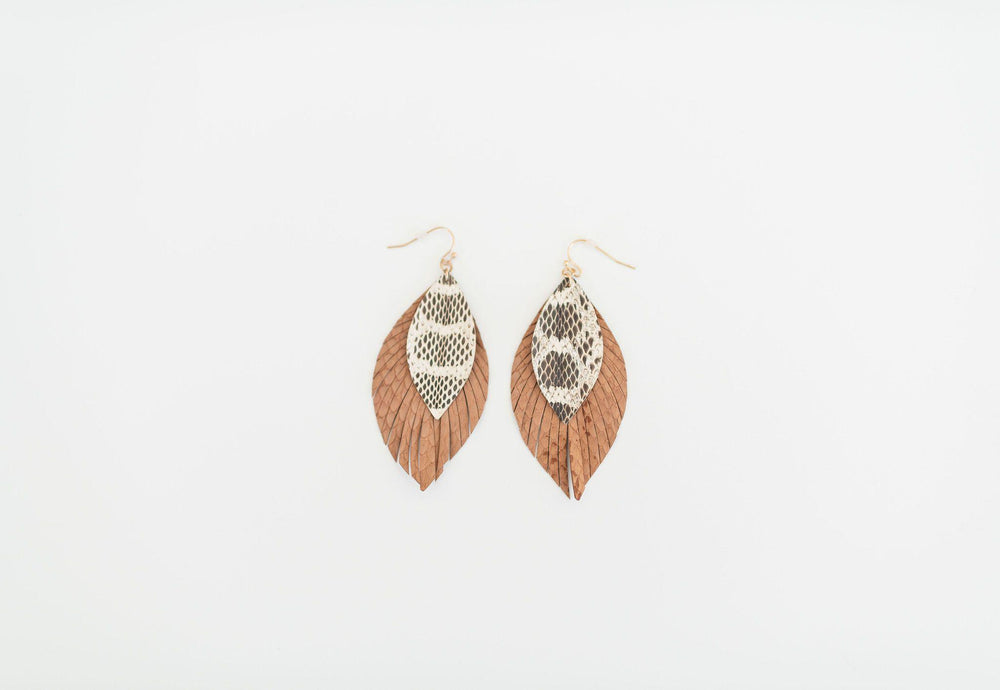 tan fringe edges leather earring snake detail available online at vetue boutique