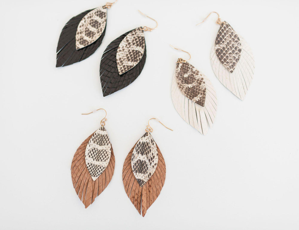 black tan white fringe edges leather earring snake detail available online at vetue boutique