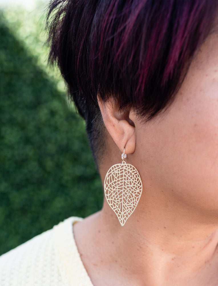 gold filigree leaf drop earrings available online at vetue boutique