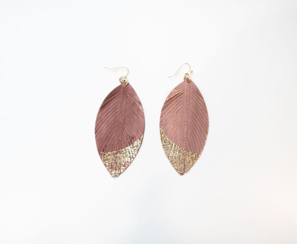 mauve fringed feather shaped leather earrings available online at vetue boutique