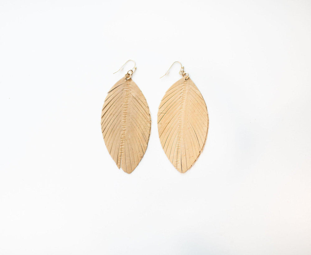 taupe fringe leather earrings available online at vetue boutique