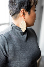 taupe leather earrings available online at vetue boutique