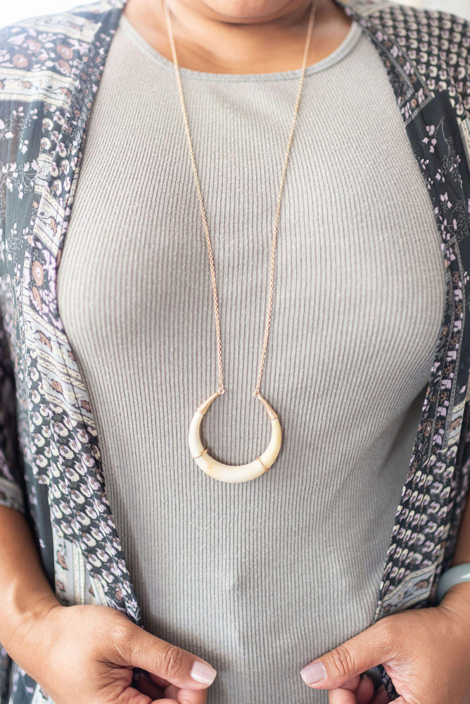 lightweight faux stone and gold crescent long necklace