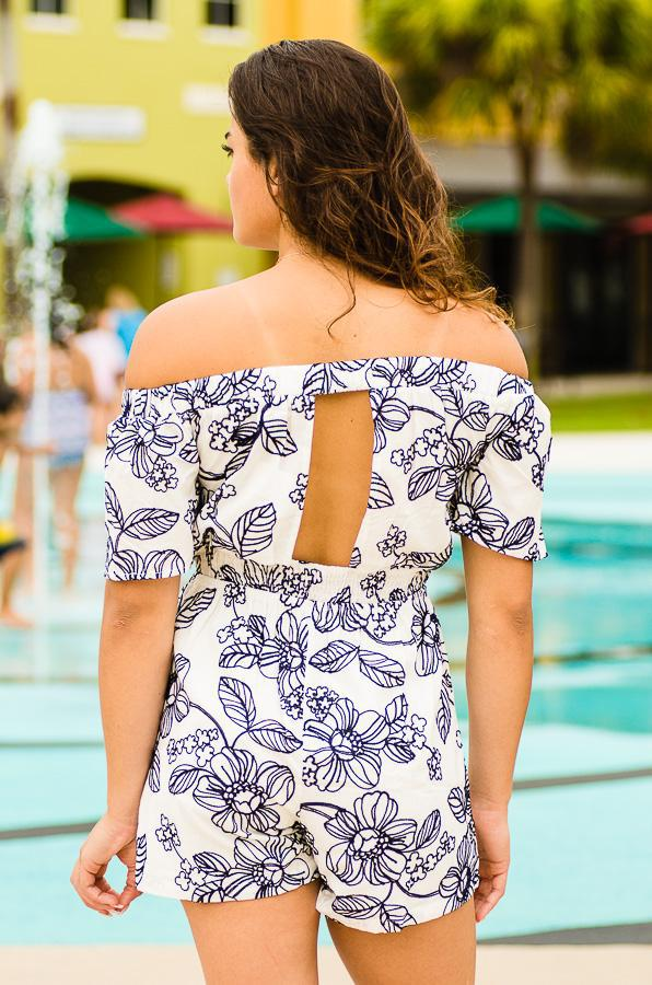 off shoulder romper with floral stitching and pocket