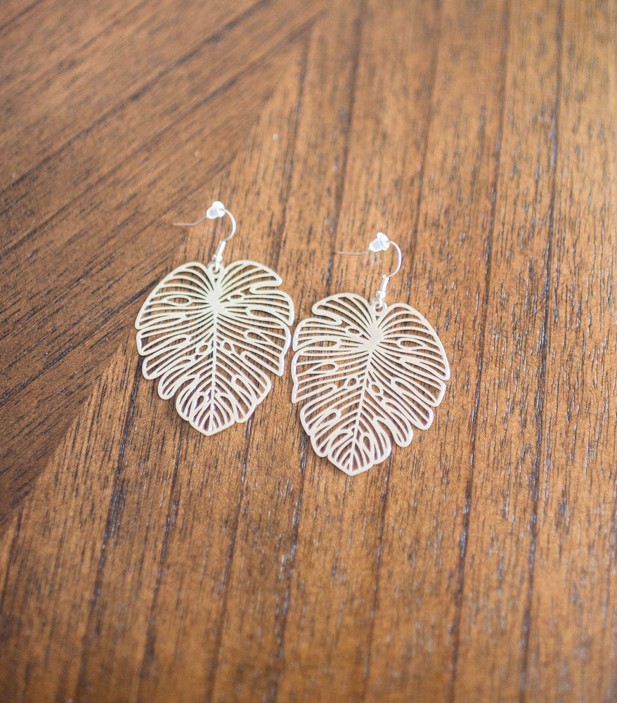 gold monstera leaf statement earrings in gold available online at vetue boutique