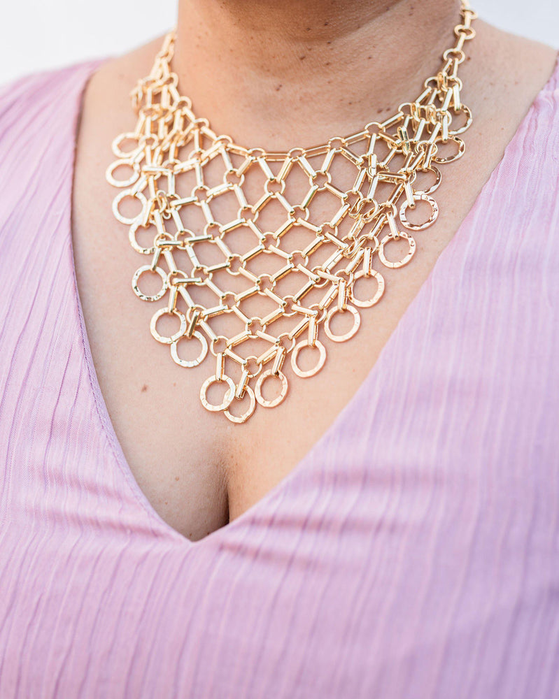 gold statement chain mail necklace available online at vetue boutique
