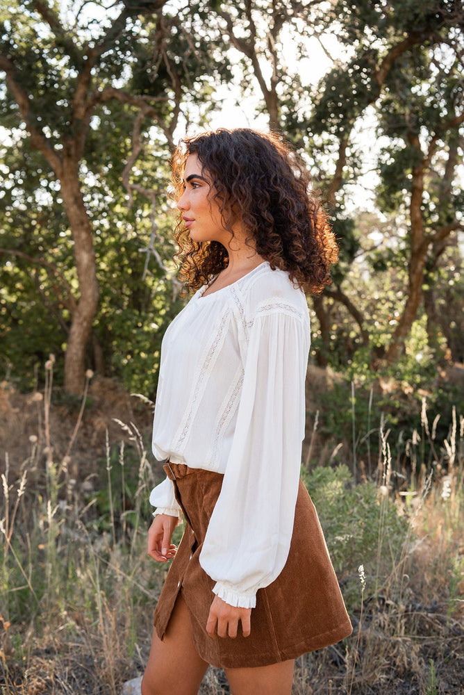 sleeves on lace trimmed top available online at vetue boutique