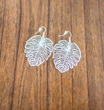 silver monstera leaf earrings available online at vetue boutique