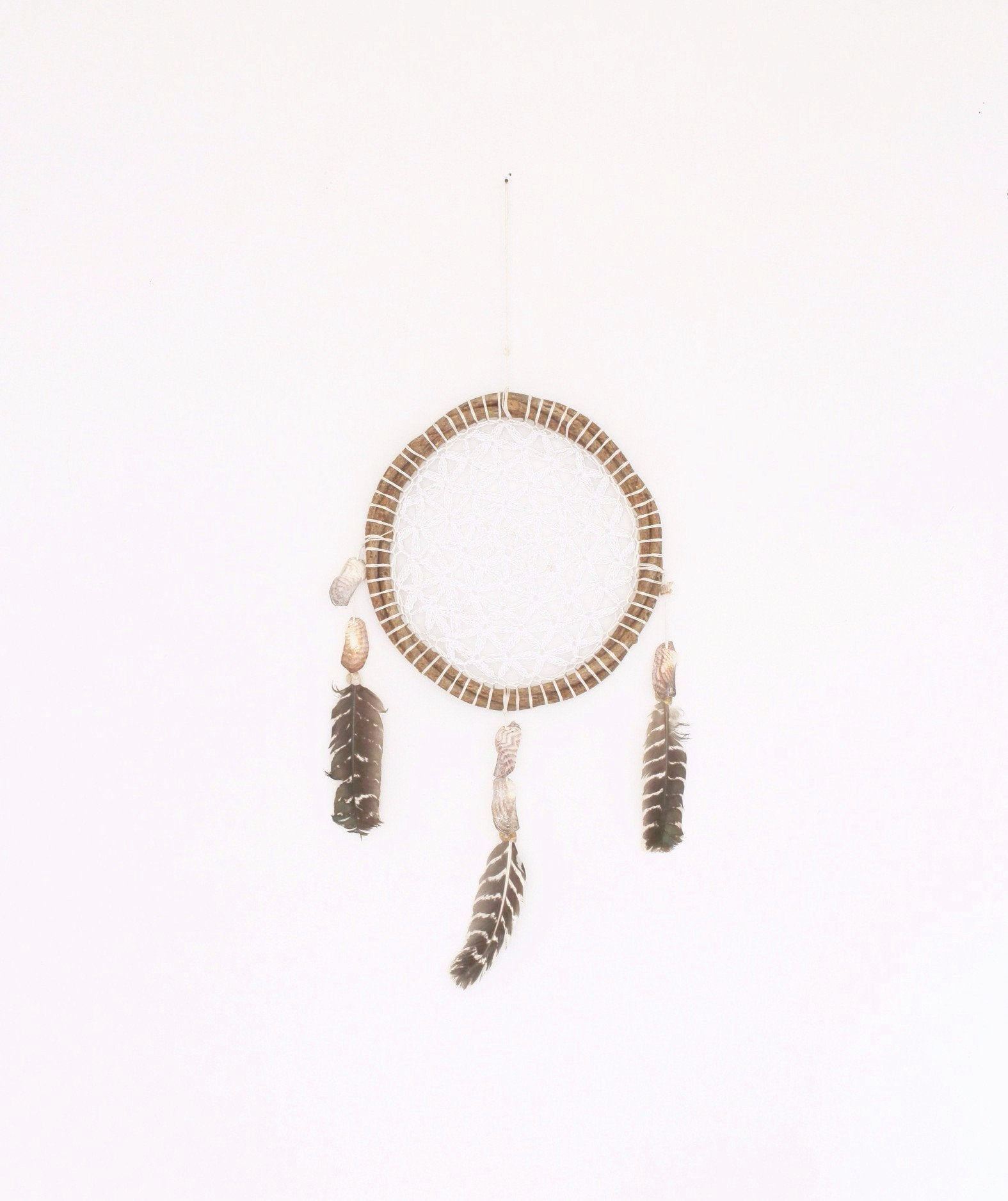 small mexican hand made dream catcher in white