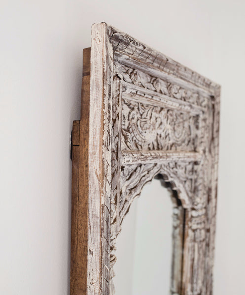hand carved wooden mirror with arched frame in white washed