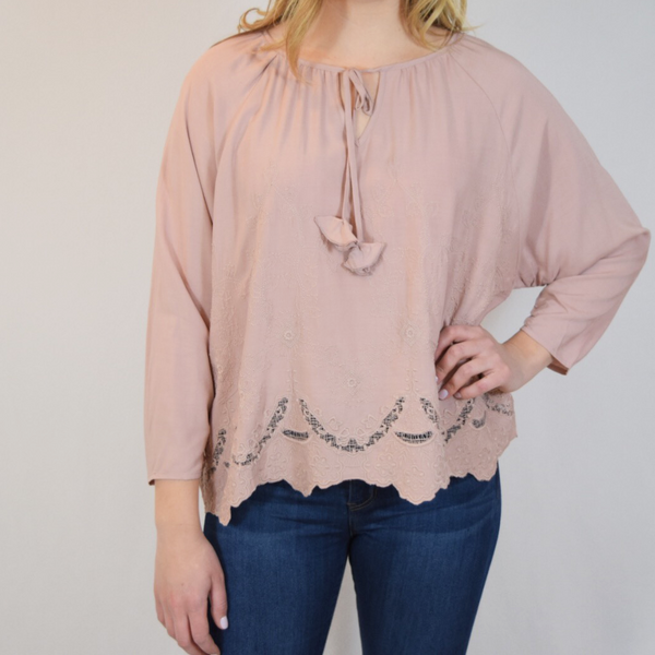 embroidered hem top with tassel detail