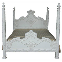 beautifully carved four poster bed with high turrot posts in antique white