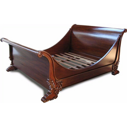Luxury French brodsworth sleigh bed with detailed intricate carvings at the feet