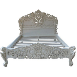 French rococo bed intricately carved with fine detail and finished in a stunning antique white