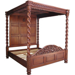 Janna four poster bed - spiraling pattern on all four posts leading up to the canopy. intricately carved with full head board