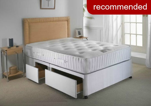 our recommended mattress, pictured on a plain bed