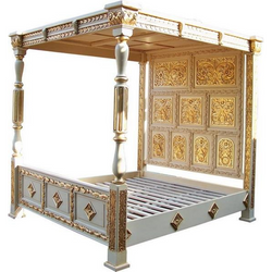 intricately carved luxury tudor style four poster bed with canopy and high detailed headboard - finished in white and gold