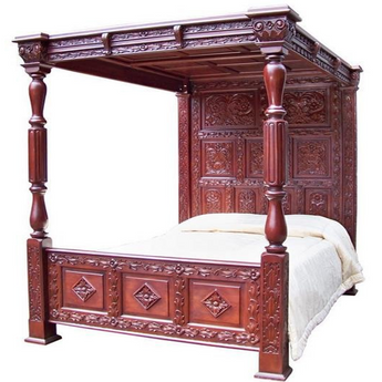 Luxury Tudor style four poster bed with canopy. Intricately carved detail to the full headboard and all sections. Solid mahogany with a wax finsih
