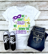 """We Don't Hide The Crazy"" Mardi Gras Graphic Tee"