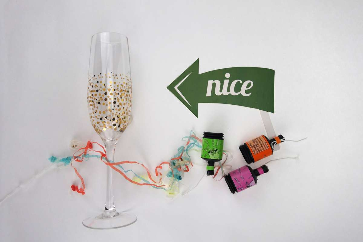 Champagne glass and colourful corks