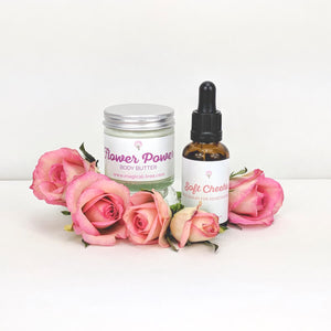 Soft Cheeks Face Serum and Flower Power Body Butter with rose flowers
