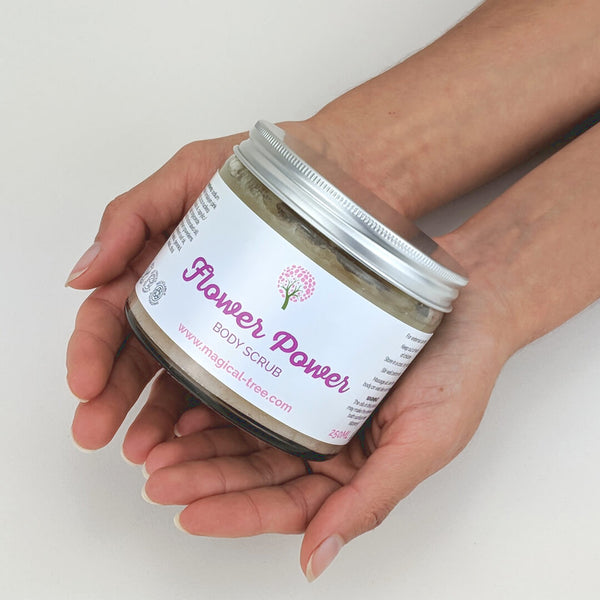 Hands holding Flower Power body scrub 250ml, exfoliating with geranium | Magical Tree