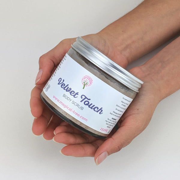 Hand holding a jar of Velvet Touch body scrub 250ml, exfoliating with lavender and chamomile | Magical Tree