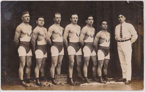 Vintage photo men in rows (track team in white)