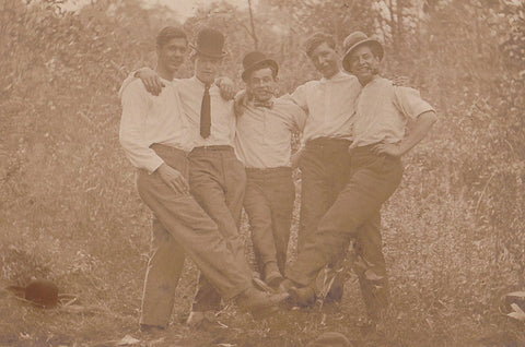 vintage snapshot five guys with feet together.