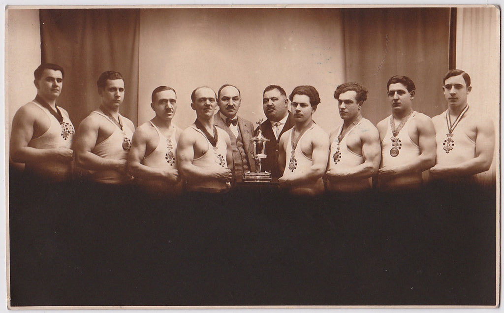 Men in Rows vintage real photo postcard wrestling team with trophy