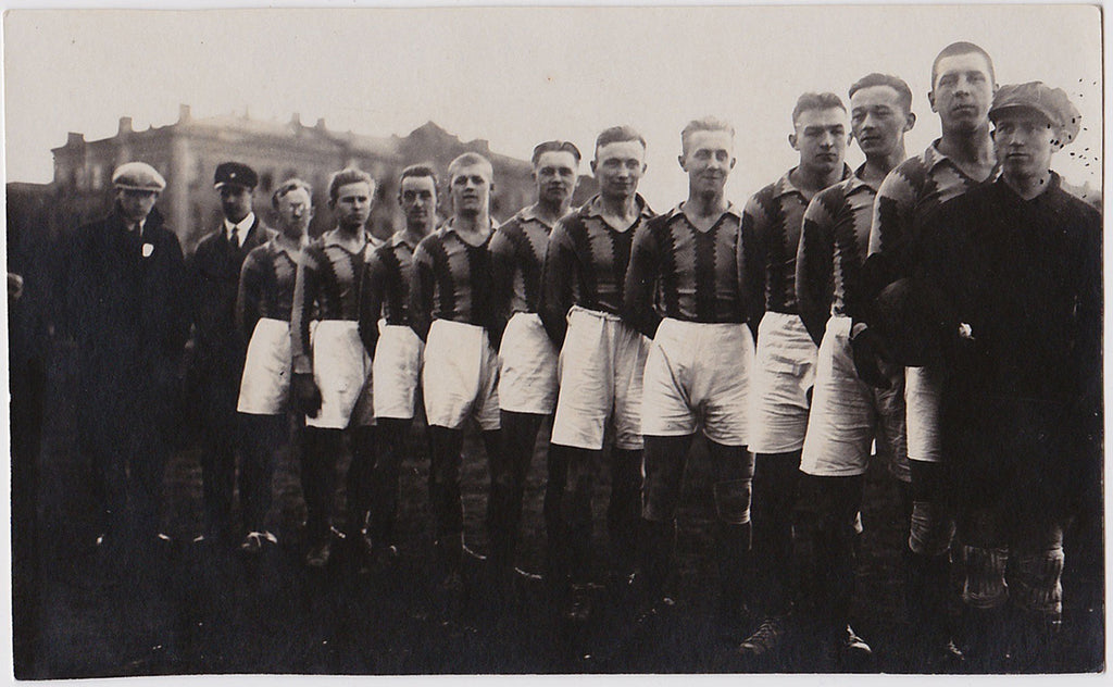 Vintage real photo postcard athletes in a row